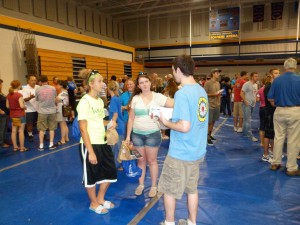 Pilgrim member George C. Heil talks to two of the more than 450 new LeTourneau students at the University's 2012 Church Fair. Pilgrim's booth, sponsored by the congregation's Missions and Evangelism Committee, also offered bottled water, homemade cookies, ink pens, spiral notepads, and church brochures.