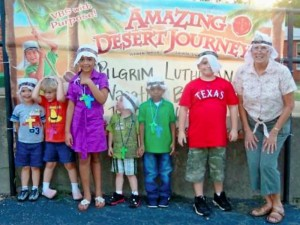 2012 VBS Storyteller Barbara Wuthrich (far right) poses with her students wearing their desert headgear.