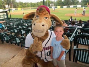 Pilgrim Member Cooper Sampson poses with Boomer, the East Texas Pump Jacks mascot named for the city's oil boom, at the July 2012 Once-a-month Social Outing.