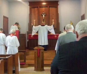 Pastor Galler leads prayers in the congregation's 60th Anniversary Vespers Service. Over the course of a liturgical service, Lutheran pastors represent both God to the congregation and the congregation before God.