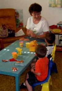 Longtime Sunday School teacher Sharon Sampson begins the August 5 Pre-Kindergarten class by forming the lesson theme out of Play-Doh.
