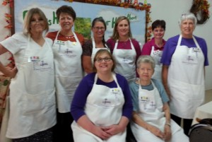 Ladies of the Pilgrim LWML Society sport their new aprons for the 2013 Fall Rally they hosted at Pilgrim. In the back row from left to right are Sallye Key, Sharon Sampson, Shannon Gage, Sarah Land, Elaine Navaille, and Barbara Wuthrich. In the front row from left to right are Angela Sampson and Jeanette Paetznick.